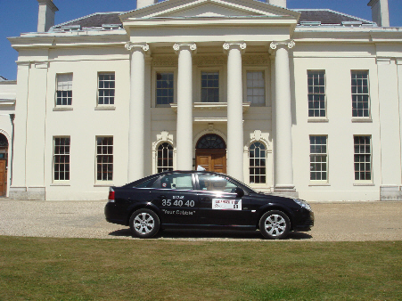 Saloon car outside Hylands House...
