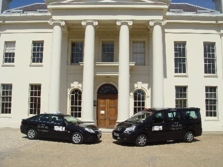 Saloon car and Peugot MPV outside Hylands House...